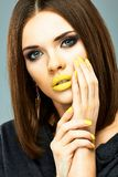Beauty woman face portrait with yellow lips Stock Photography