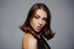 Beauty woman face. Pretty girl with perfect skin. Hairstyle styling. Fashion, beauty, cosmetics. Makeup, smooth skin stock images