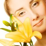 Beauty woman face with yellow lily flower Royalty Free Stock Image