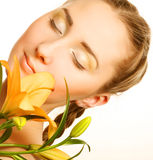 beauty woman face with yellow lily flower Royalty Free Stock Photography