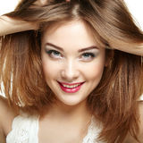 Beauty woman face. Young girl smiling. Isolated on white backgro Stock Photography