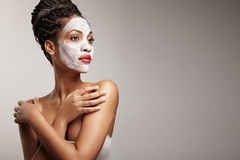 Beauty woman with a facial mask Royalty Free Stock Photos