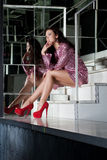Beauty woman in fashion pink dress on stairs Royalty Free Stock Photography