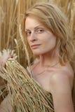 Beauty woman on field Royalty Free Stock Image