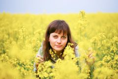 Beauty woman in flower field Stock Photography