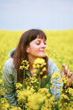Beauty woman in flower field Stock Image