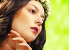 Beauty woman with flower on green Royalty Free Stock Photography
