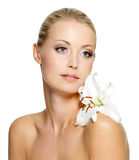 Beauty woman with flower on shoulder Stock Images