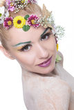 Beauty woman with flowers in hair looks at you Royalty Free Stock Photography