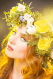 Beauty woman with flowers on hair Stock Photos