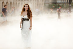 Beauty woman in fog Royalty Free Stock Image