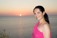 Beauty woman in front of sea sunset Stock Image