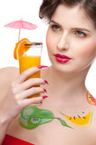 Beauty woman with fruit bodyart and juice Stock Photos