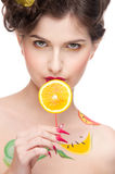 Beauty woman with fruit bodyart and juicy o Royalty Free Stock Photography