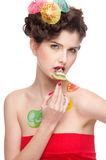 Beauty woman with fruit bodyart and kiwi Stock Photography