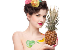 Beauty woman with fruit bodyart and pineapp Royalty Free Stock Photo