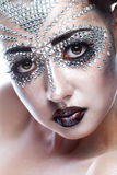 Beauty woman in futuristic makeup Royalty Free Stock Photography