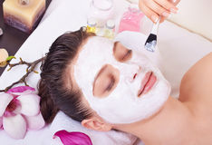 Getting facial mask Stock Photography