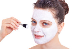 Beauty woman getting facial mask isolated Stock Photos