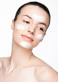 Beauty woman girl with face cream natural makeup Royalty Free Stock Photo
