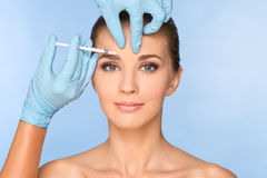 Beauty woman giving botox injections. Beauty natural woman giving botox injections Stock Photo
