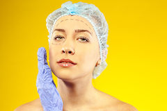 Beauty woman giving botox injections. studio stock photography