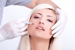 Beauty woman giving botox injections Stock Photography