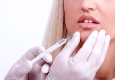 Beauty woman giving botox injections Royalty Free Stock Photo
