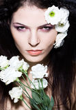 Beauty woman glamour portrait makeup white flowers. Beauty woman,glamour  portrait, makeup presentation, white flowers, studio shot on dark background Royalty Free Stock Photography