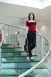 Beauty woman on glass stair. In modern interior Stock Photography