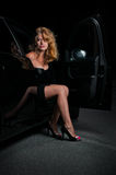 Beauty woman going out of car. Beauty woman going out of glam, black car Royalty Free Stock Image