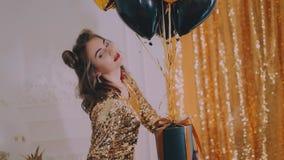 Beauty woman in gold dress stock video