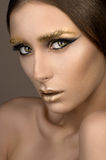 Beauty woman with gold make-up Royalty Free Stock Images