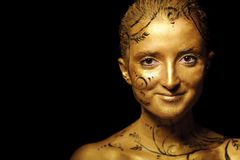 Beauty woman with golden skin Stock Photo