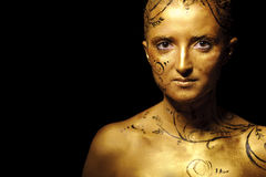 Beauty woman with golden skin Stock Image