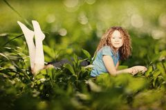 Beauty woman in a green grass Royalty Free Stock Photos