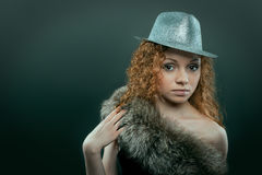 Beauty woman in hat and fur studio shot Royalty Free Stock Photo