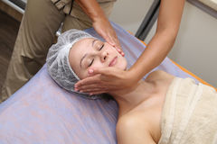 Beauty woman having cosmetic massage Stock Images