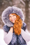 Beauty woman having fun outside on winter snowy day Royalty Free Stock Photos