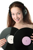 Beauty woman in headphonew with gramophone disc Royalty Free Stock Photography