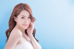 Beauty woman with health skin. Beauty woman with charming smile to you with  blue background, asian Stock Images