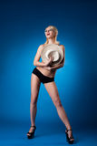 Beauty woman hide breast by straw hat Stock Image