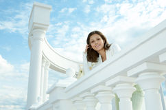 Beauty woman on historic building Stock Photography