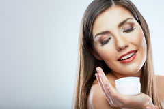 Beauty woman hold face cream Royalty Free Stock Photography