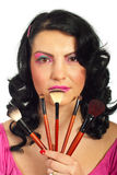 Beauty woman holding brushes set Royalty Free Stock Photography