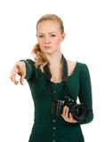 Beauty woman holding a camera and pointing Royalty Free Stock Image