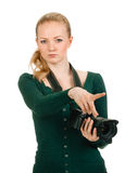 Beauty woman holding a camera and pointing Royalty Free Stock Images