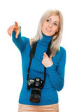 Beauty woman holding a camera and pointing Royalty Free Stock Photo