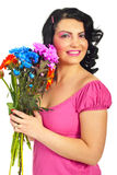Beauty woman holding flowers bouquet Stock Photo