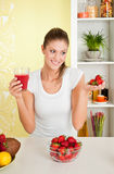 Beauty woman holding a glass of strawberry j Royalty Free Stock Photos